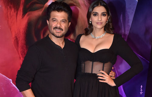 Sonam Kapoor $exy Black Outfit complimenting father Anil Kapoor